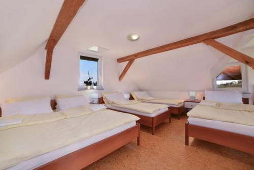 Duplex Gallery - Bedroom with a large double bed and 3 single beds